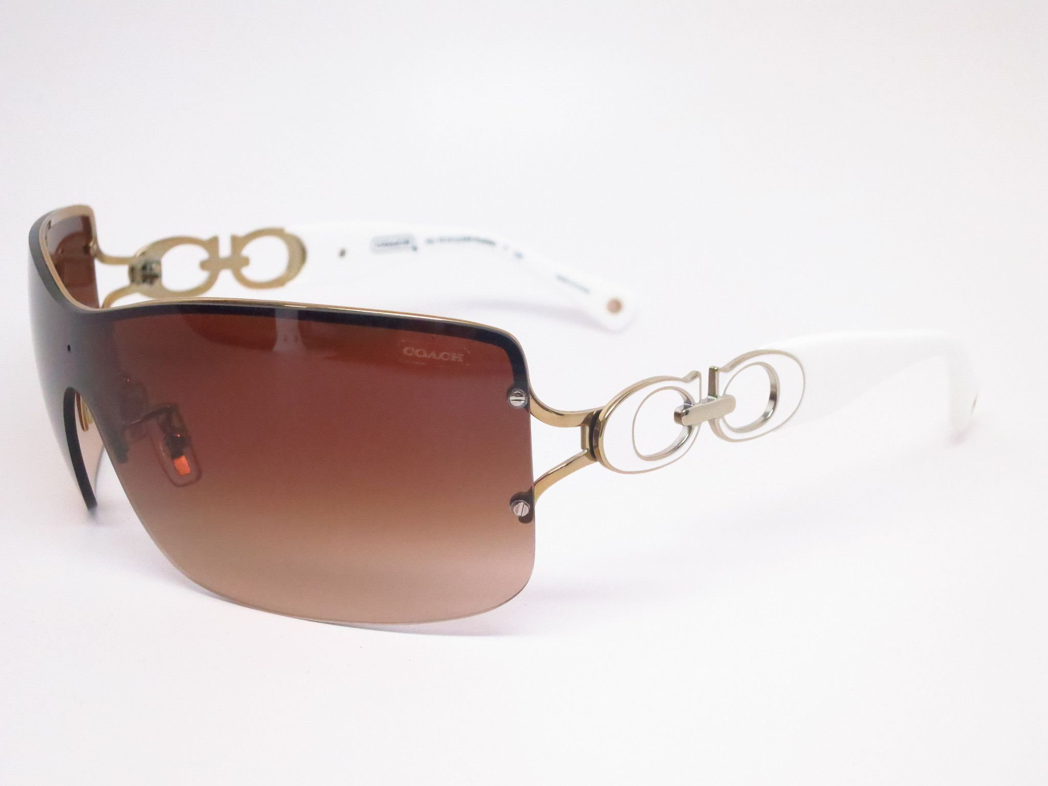 2f5c73bf573 Coach Noelle Product Details Model Number   HC 7018 Model Name   Noelle -  Color Code   9118 13 Frame Color   Gold White Lens Color   Dark Brown  Gradient ...