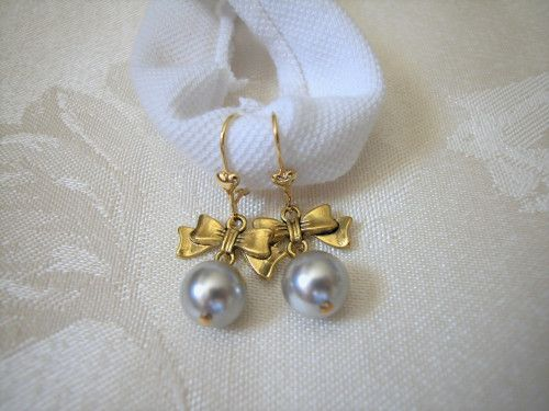 Swarovski light grey crystal pearl gold bow connector earrings.
