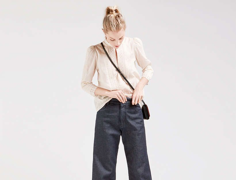 Together, this mash up of eras—a Victorian-inspired top, '90s throwback jeans, and 50s kitten heels– come together perfectly to assemble a work-appropriate, yet not too stuffy, outfit.