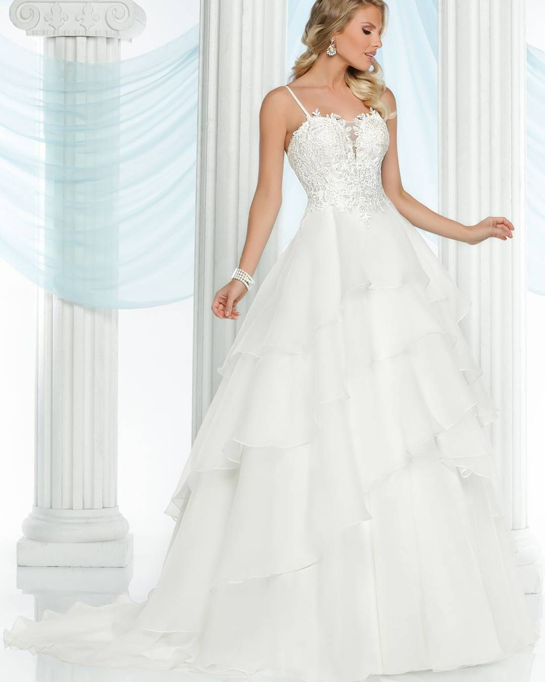 e63bb2b19 Style #50411 is simply stunning! It features lace on the bodice and a  layered skirt.