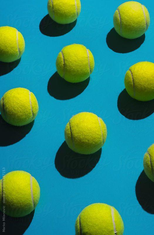 Tennis balls arranged. by Marko Milanovic for Stocksy United