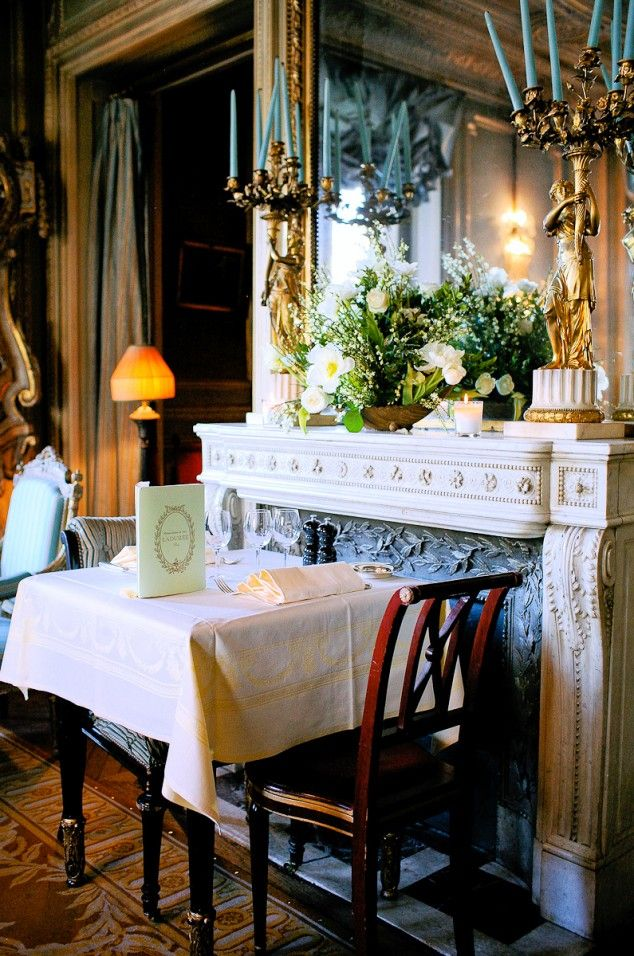 Upstairs tea room, Ladurée, Paris - Champs Élysées location.  It t feels a bit like stepping back in time  --  delicate porcelain and an eclectic mix of antique chairs suitable for royalty.