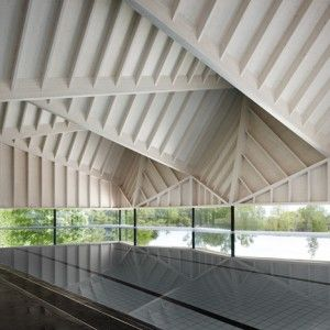 Angular+wooden+roof+reduces+sound+reverberation++inside+swimming+pool+by+Duggan+Morris