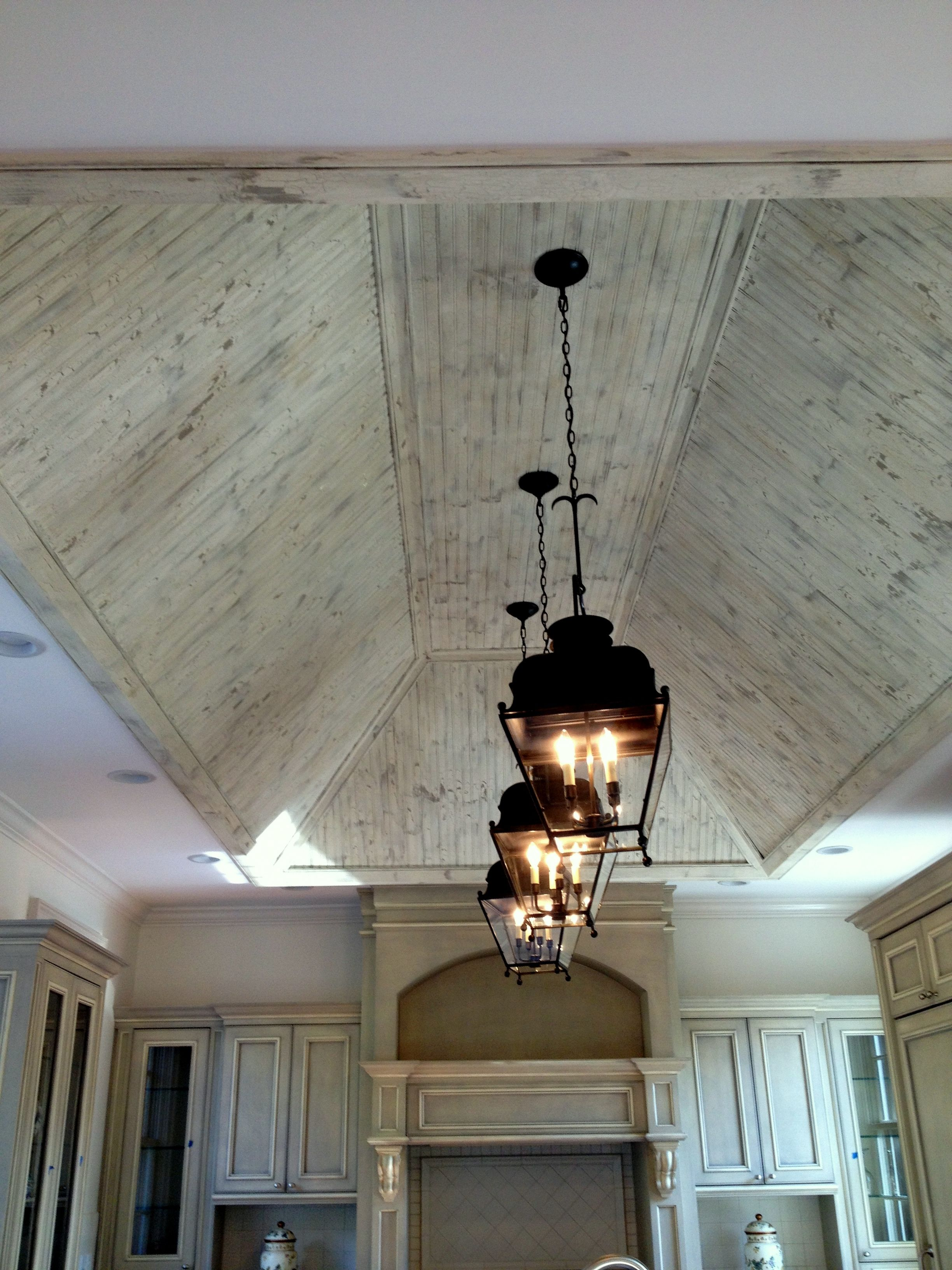 This kitchen ceiling was distressed and antiqued to compliment this