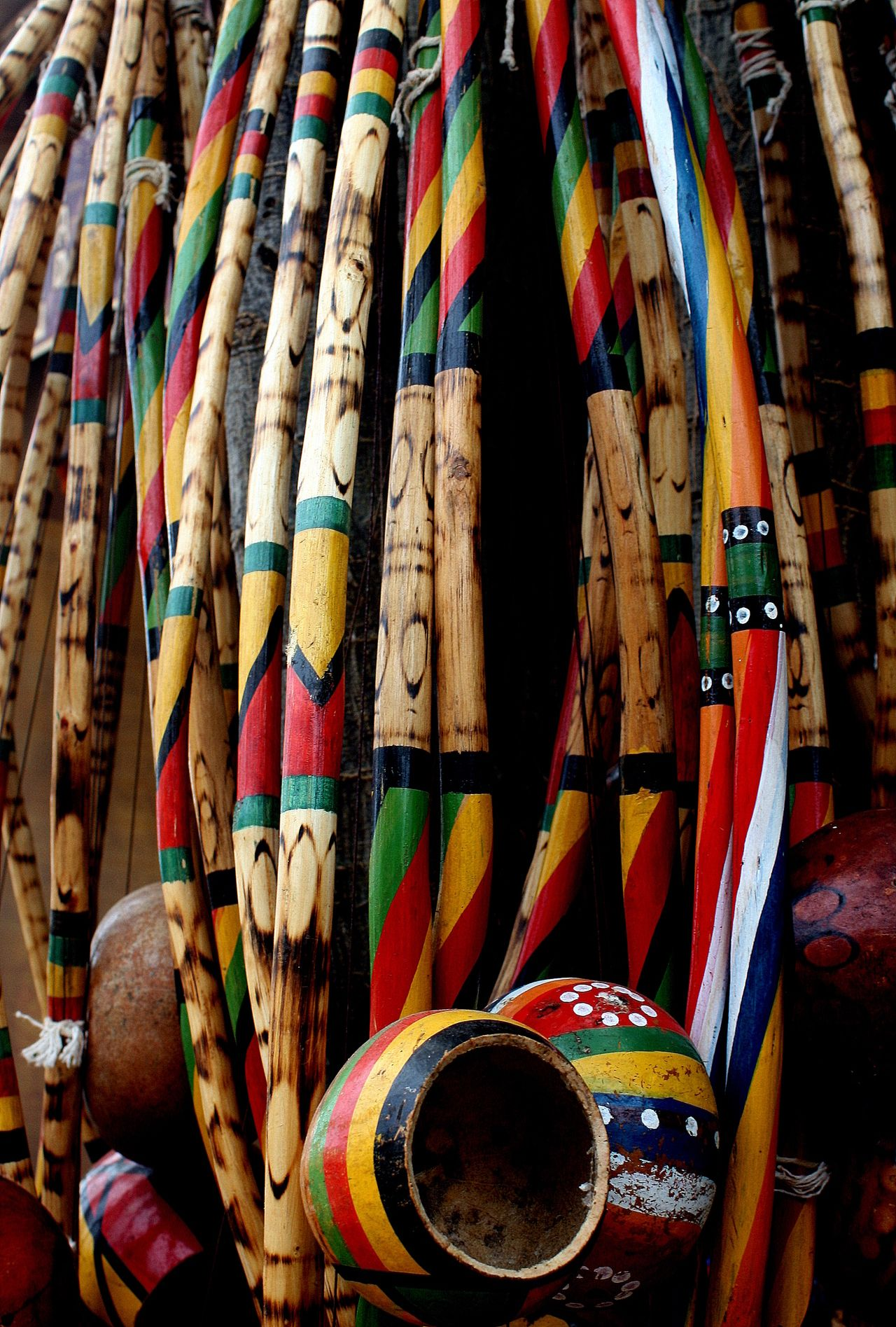 Colorful berimbau. The berimbau is a single-string percussion instrument, a musical bow, from Brazil. The berimbau's origins are not entirely clear, but there is not much doubt about its African origin, as no Indigenous Brazilian or European people use musical bows, and very similar instruments are played in the southern parts of Africa.