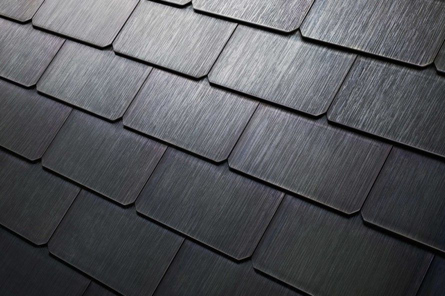 Tesla S New Solar Roof Is Actually Cheaper Than A Normal Roof Tesla Solar Roof Solar Roof Solar Roof Tiles