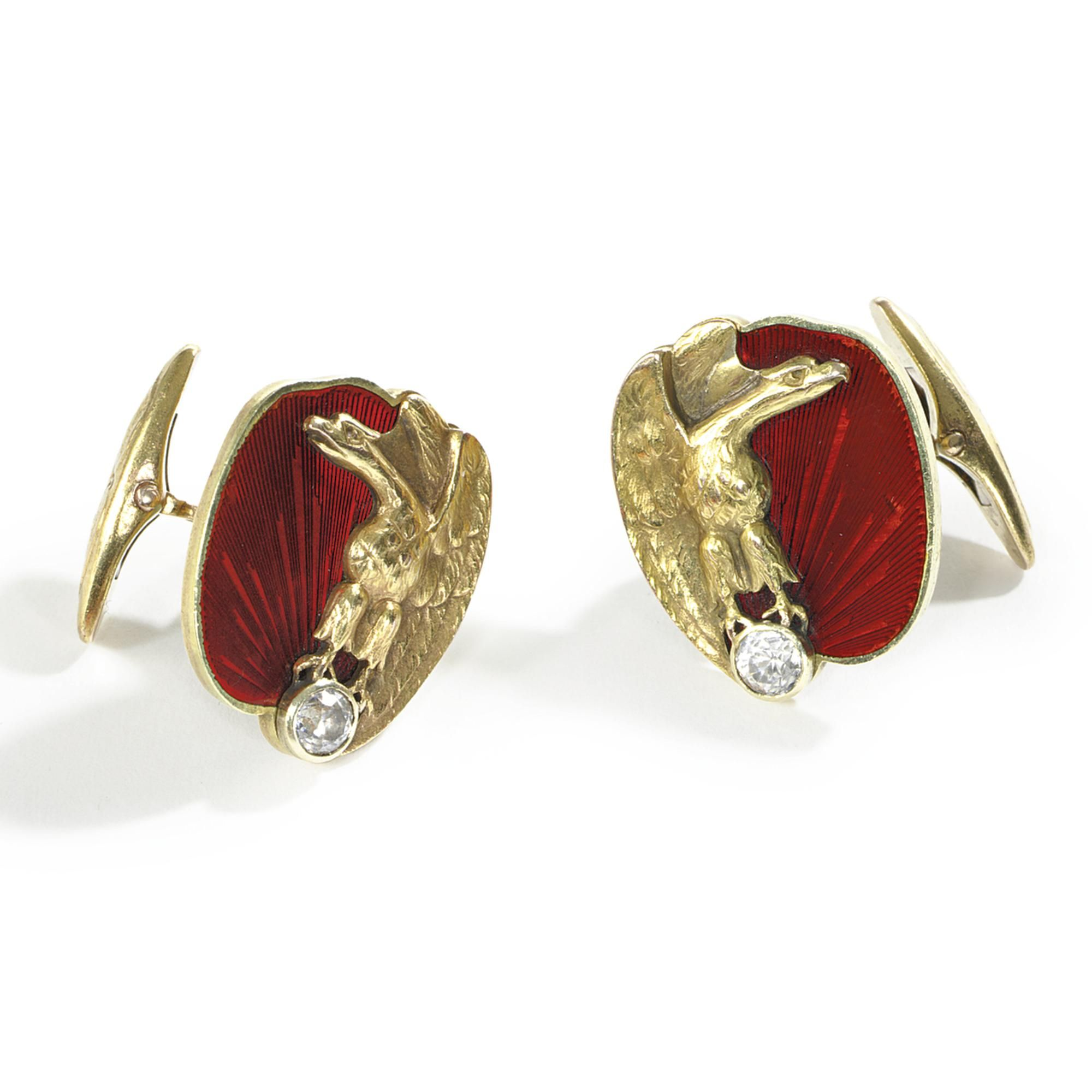 A PAIR OF FABERGÉ GOLD, ENAMEL, AND JEWELED CUFFLINKS, WORKMASTER KNUT OSKAR PIHL, MOSCOW, CIRCA 1890 enameled translucent strawberry red over a guilloché ground, each disk applied with a gold eagle grasping a diamond in its claws, the bars chased with two leaves marked with initials of workmaster and 56 standard Width 7/8 in. 2.2 cm Estimate 8,000 — 12,000 USD LOT SOLD. 27,500 USD