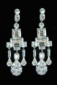 A wedding gift to Queen Elizabeth  from her parents King George and Queen Elizabeth. These are known as the King George VI Chandelier earrings.