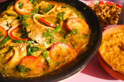Fish Moqueca (Moqueca de Peixe)-One of Brazil's most authoritative dictionaries, Houaiss, defines a moqueca as: a stew of fish, seafood, meat or eggs, made with coconut milk and  dendê oil plus seasonings (cilantro, onion, bell peppers, dried shrimps and chili peppers), cooked preferably in a clay casserole and served in the same dish. Originally from northeastern Brazil, especially Bahia, but now considered characteristic of Brazilian cuisine in general, being found in various states of…