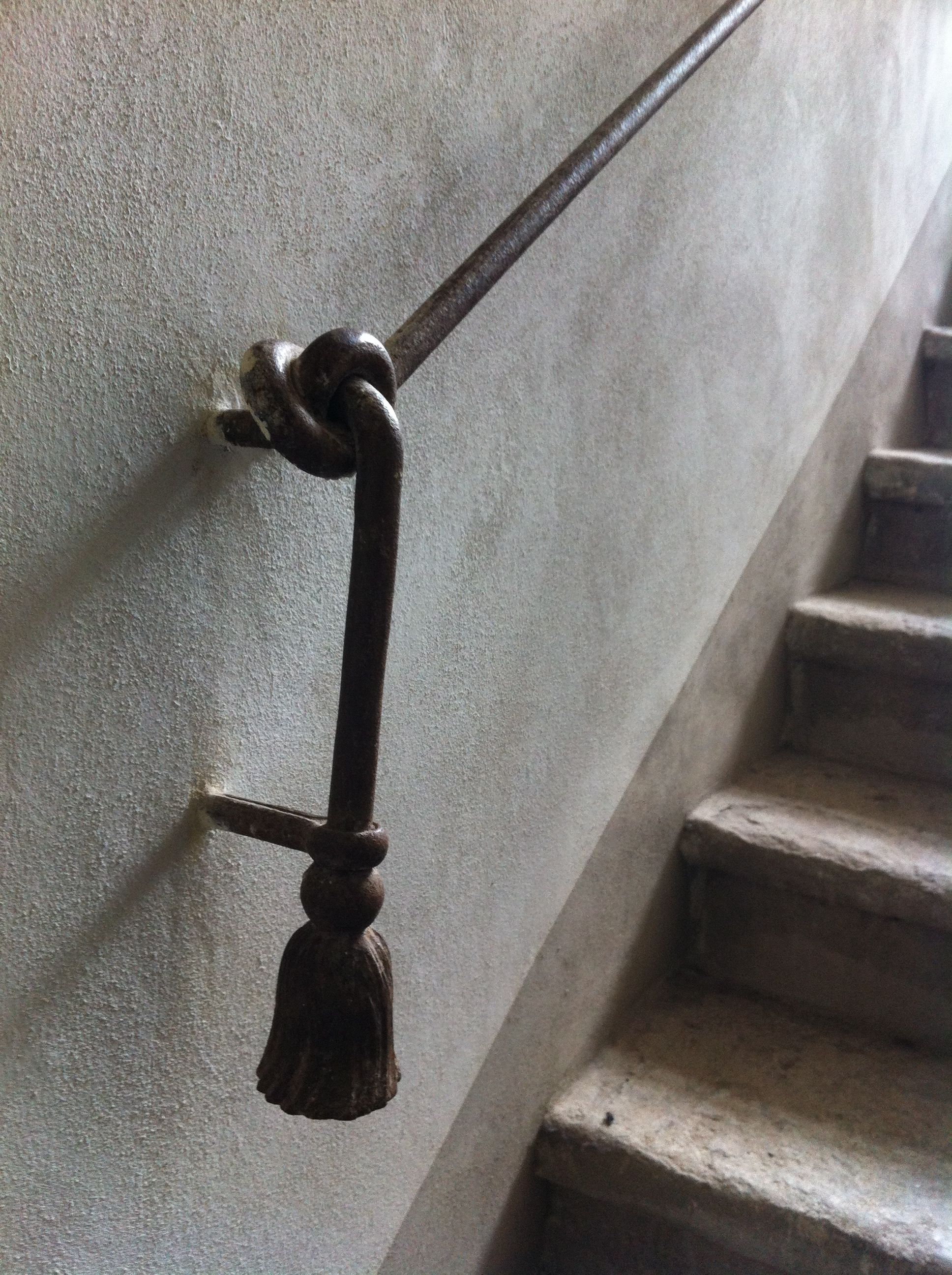 Iron Railing Made To Look Like A Rope Tied Into A Knot Iron