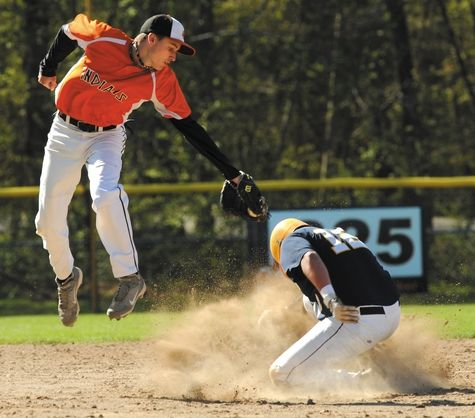 Montville shortstop Nick Kinder reaches back a bit too late to tag Ledyard's Kyle Perry, who steals second base during Friday's ECC Medium baseball game. Montville won 11-0.