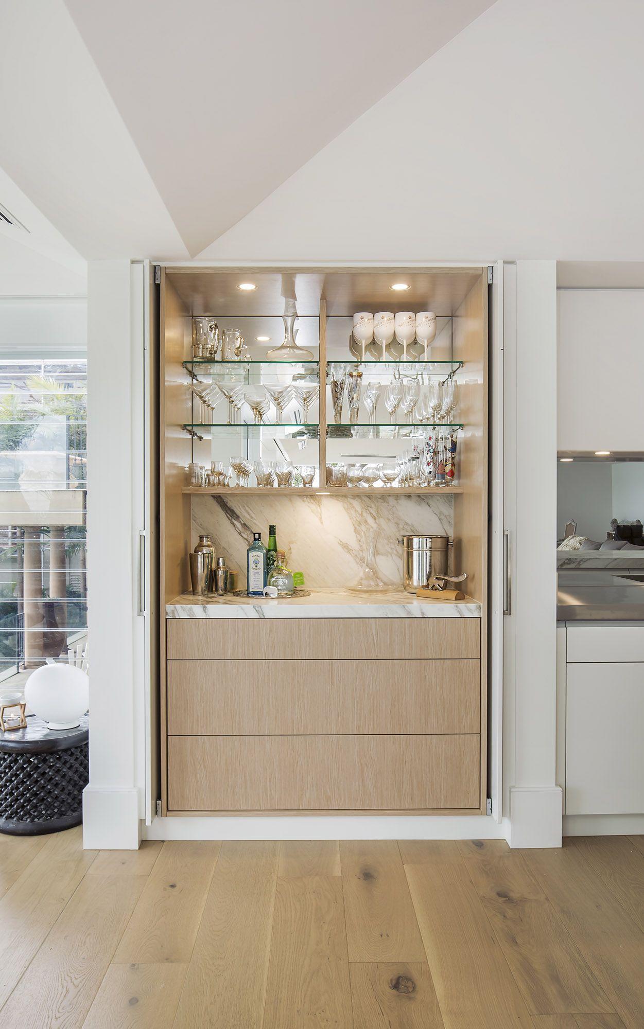 Hidden Drinks Bar Luxury Entertainers Kitchen With Striking Calacatta Marble Island Modern Home Bar Kitchen Bar Design Bars For Home