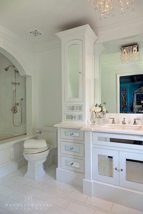 Stunning bathroom boasts arched shower alcove filled with drop-in ...