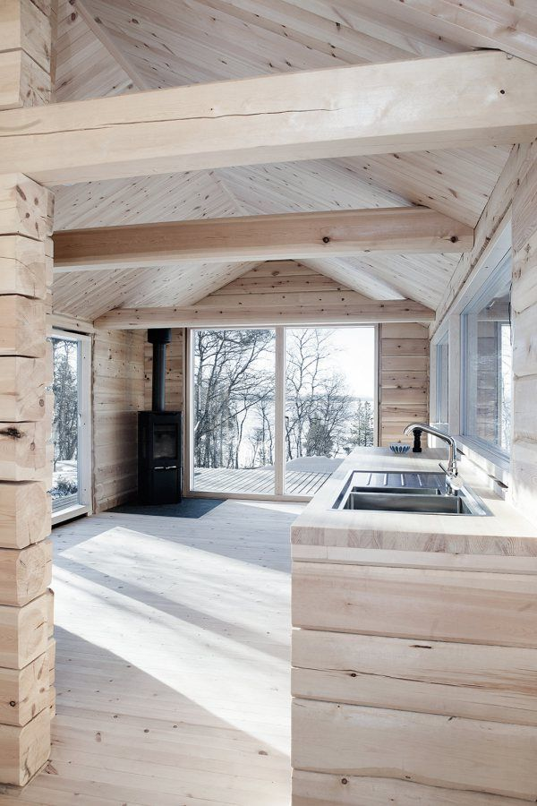 Cozy log cabin in Norway. See how we use wood in our models at Risingbarn.com.