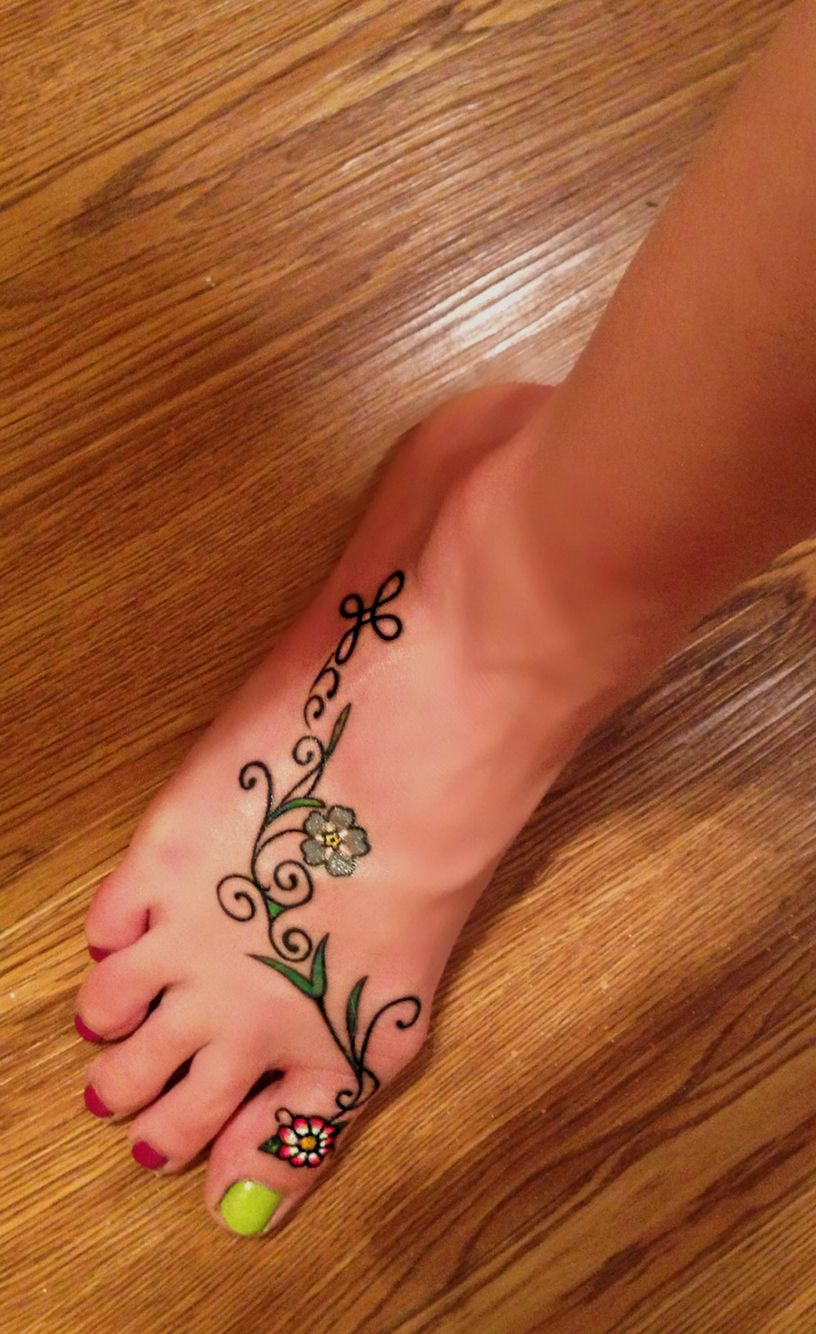 Foot vine tattoo with daisy forget me not celtic triskele knot foot vine tattoo with daisy forget me not celtic triskele knot and celtic cross my irish catholic heritage and flowers that have personal meaning izmirmasajfo Image collections