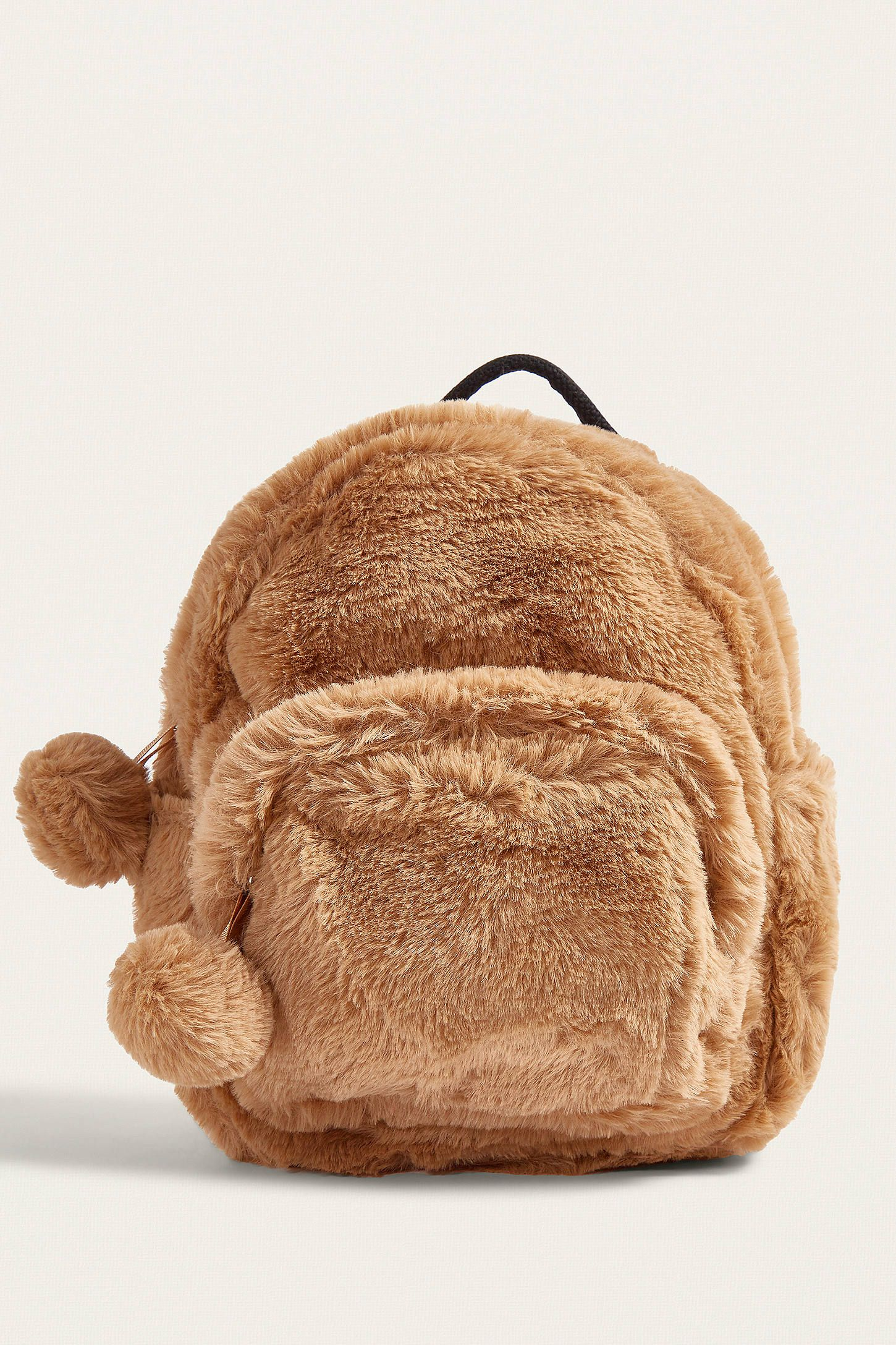 Shop UO Mini Faux Fur Brown Backpack at Urban Outfitters today. We carry  all the latest styles 3e3d77b8900c2