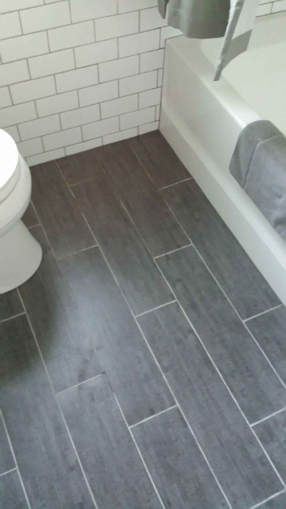 My Finished Bathroom Floor Grey Porcelain Bamboo 6x24 Staggered