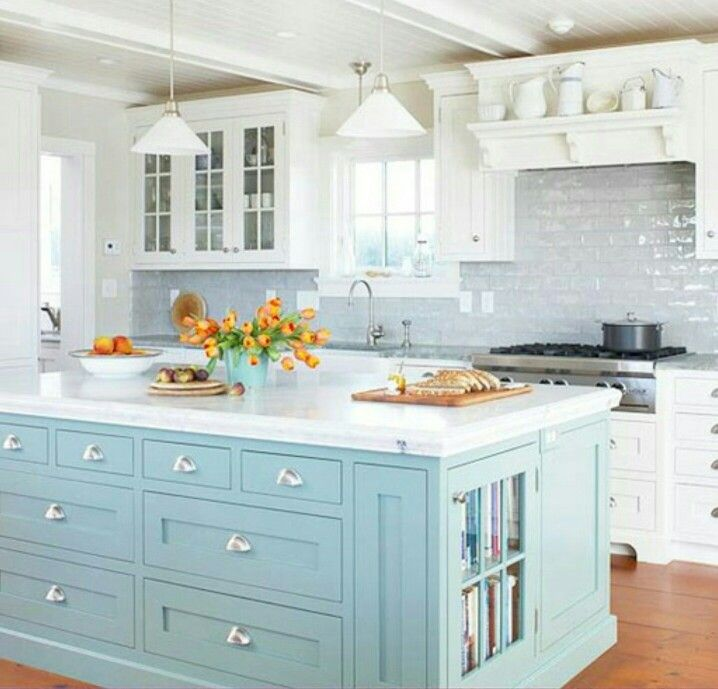 White kitchen cabinets with a different color island Kitchens