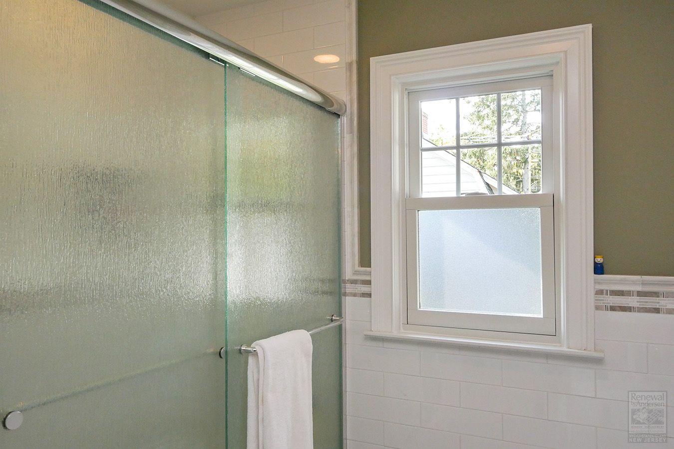 Sleek Bathroom With New Double Hung Window Renewal By Andersen In 2020 Sleek Bathroom Double Hung Windows Double Hung