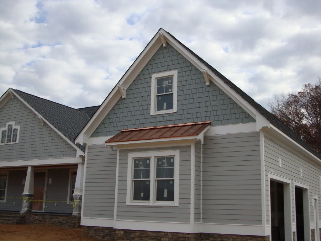 Swhites house planks are bm boothbay gray shingle color is bm puritan gray