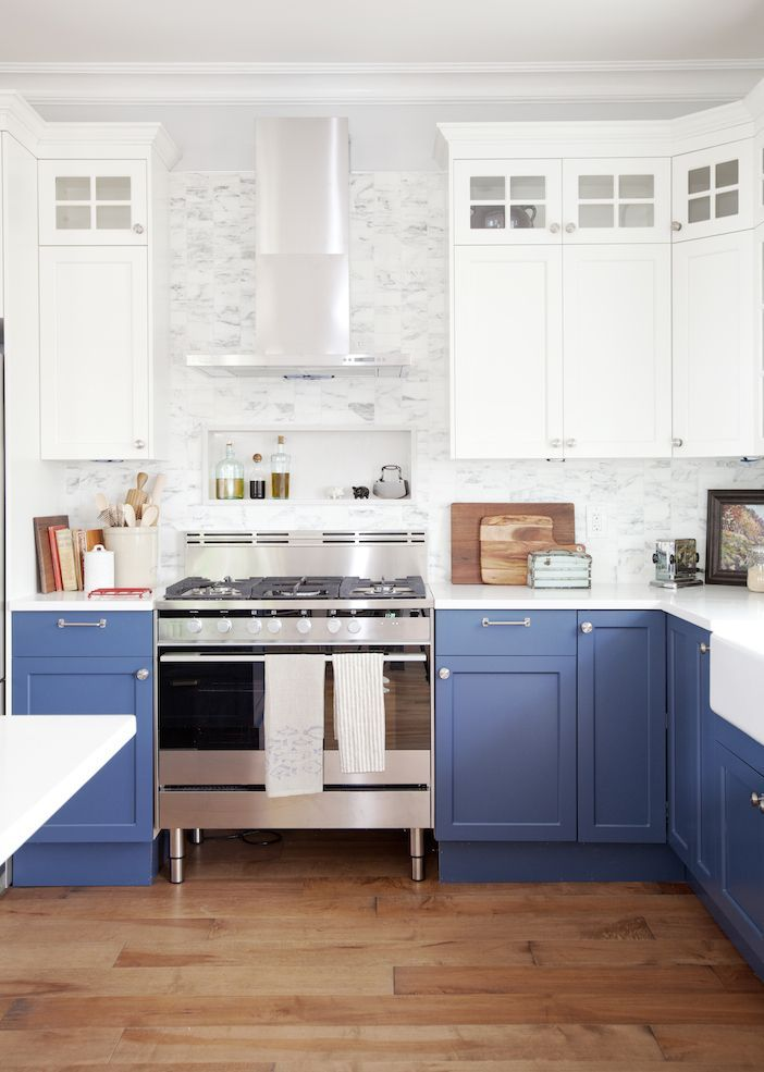 Gorgeous And Bright Medium Blue And White Painted Cabinet Tuxedo Kitchen  With Gray Tile Backsplash, Stainless Steel Appliances And A Warm Brown Wood  Floor.