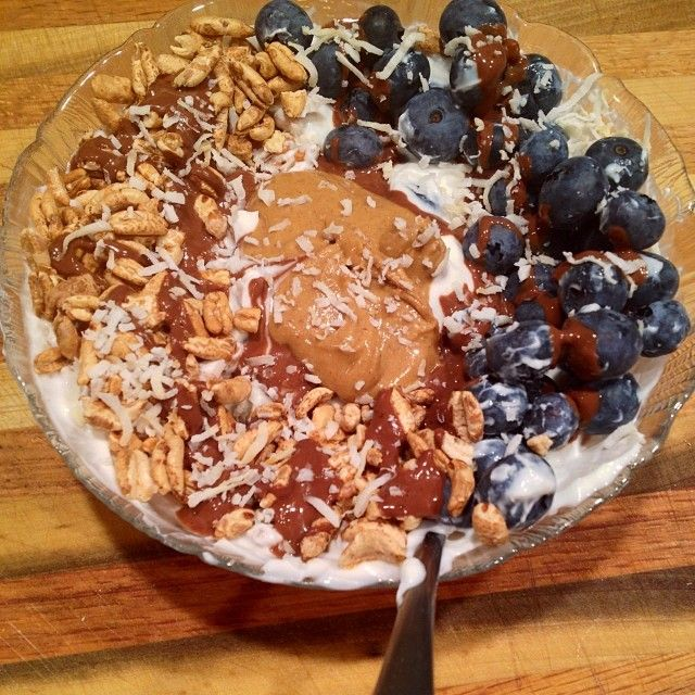 Cinnamon chocolate oats topped with a maple cappuccino cream, blueberries, puffed barley, vanilla almond milk, and some chocolate PB