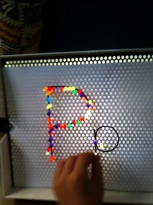 Making letters with a Lite Brite. Miller will love this since he isn't allowed to play with the Lite Brite!