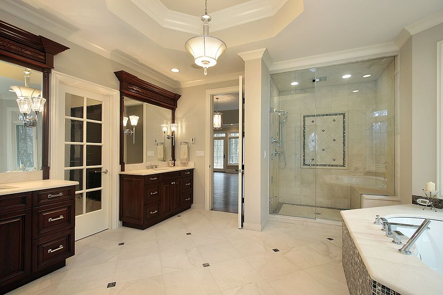luxury dark wood master bathroom master bath in new construction home with glass shower