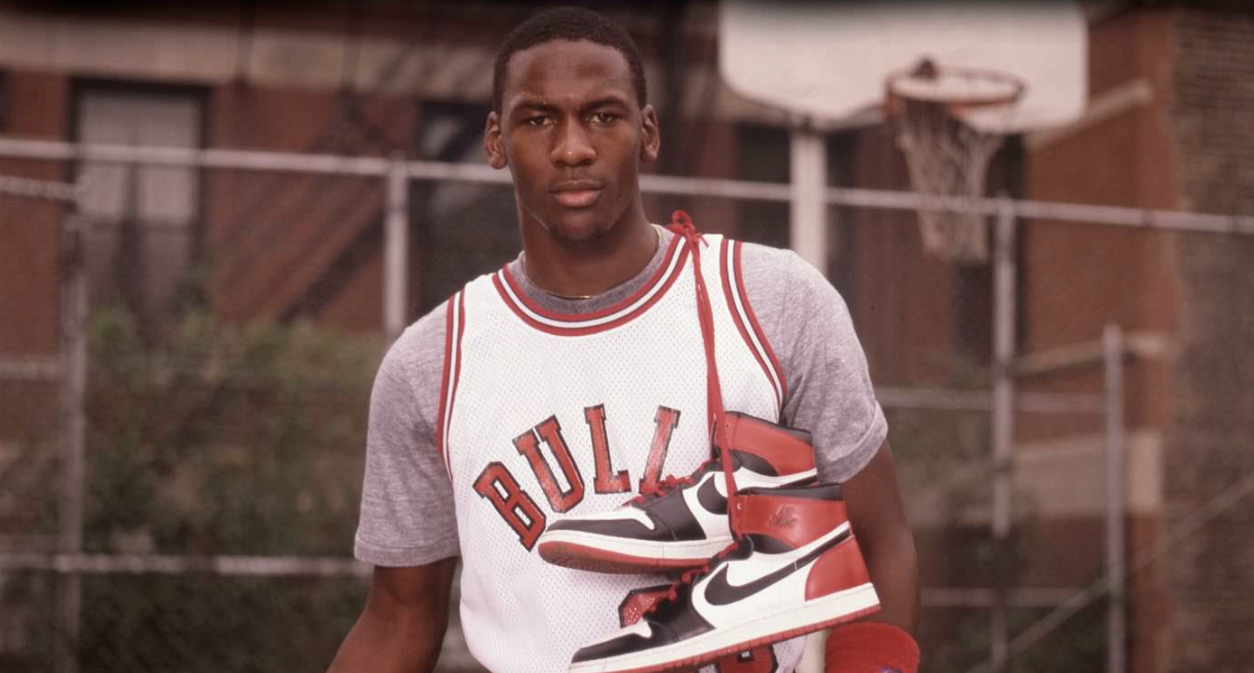 ff881709bbf Love this old shot of Michael Jordan with the classic Nike dunks hung over  his shoulder.