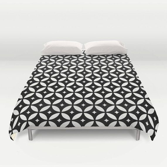 Geometric duvet cover* with black and Ivory modern flowers pattern. Designed with an unique and modern pattern this geometric duvet cover will lighten up any room. It is also a perfect gift for any kid.  • Available in Full, Queen and King Size • Hand sewn and meticulously crafted • Soft white reverse side • Decorative microfiber duvet cover • Hidden zipper offers simple assembly for easy care • Individually cut and sewn by hand • Finished with a concealed zipper