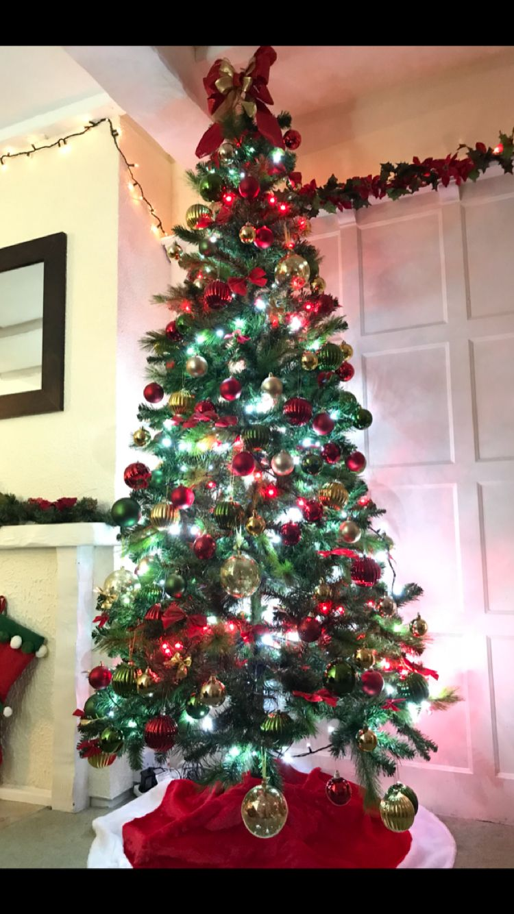 Christmas Tree With Red Gold And Green Decorations Red And Gold Bows And A Glitter Bow As A Tree Toppe Red Christmas Lights Xmas Decorations Christmas Lights