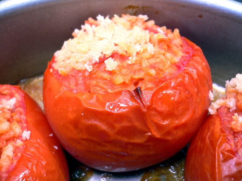 """Tomatoes filled with Rice: These are unbelievably good (only partially because I'm obsessed with tomatoes). As Luisa says, """"The rice is hot and sludgy and delectable and the tomatoes are sweet and caramelized."""""""