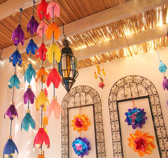 Sukkah decor with plastic bottle flowers beautiful for Plastic bottles decoration pieces