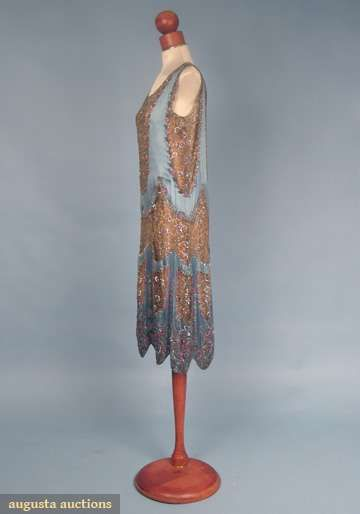 BEADED LACE & SILK DRESS, MID 1920s Blue silk satin w/ scallop shaped inserts of gold lace trimmed w/ crystal bugle beads, small crystal & pink beads, diamante & small silver sequins, scalloped hem, beaded butterflies above scallops, peach silk slip.