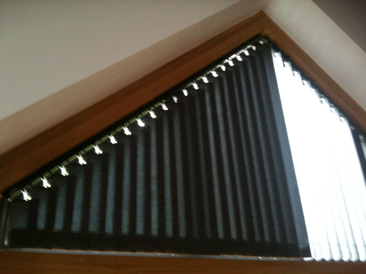 Part Closed Blinds In Triangular Window Window