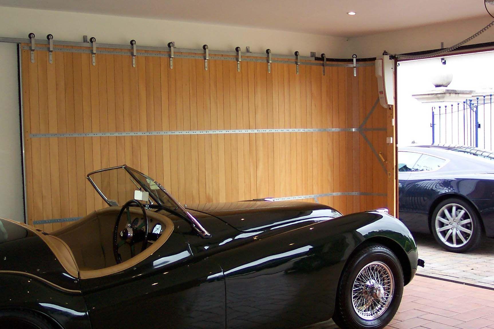 Best Idea Of Sliding Garage Doors In White Color With Black Frame In Side Design Sliding Garage Doors Custom Garage Doors Garage Doors