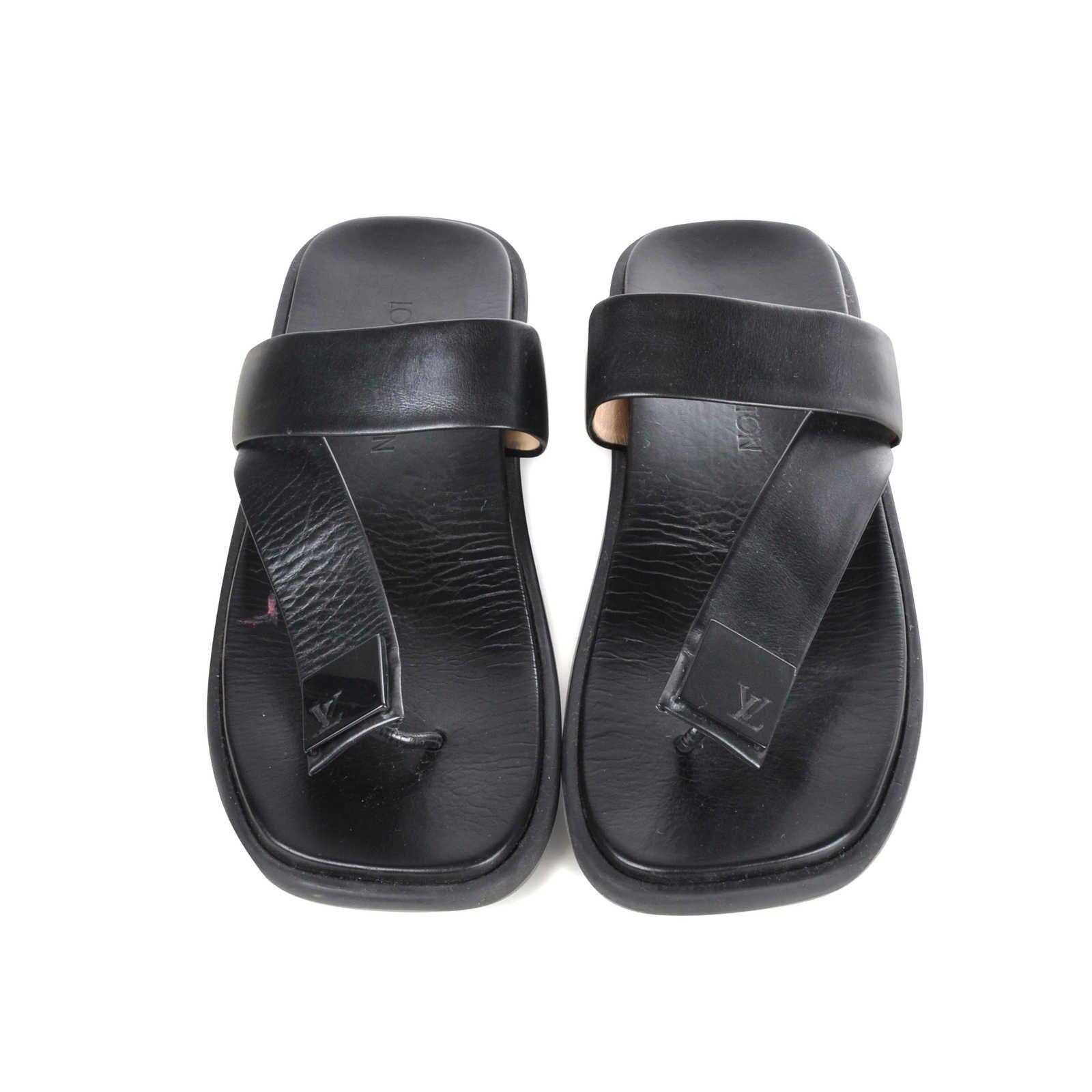 d98b1143893d Louis Vuitton rubber platform thong slippers with black leather straps  designed with a black square applique