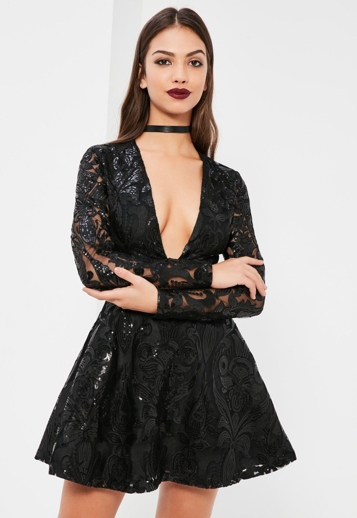 Amp up your outfit game in this beaut  flowy skater dress - featuring a  plunging neckline and long sleeves in a gorgeous lace fabric. 5ceae9ecc268
