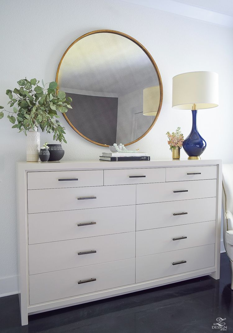 Transitional Style Master Bedroom Round Gold Mirror Navy Lamp With Brass Base Dresser Styling Bedroo Dresser Decor Bedroom Home Decor Bedroom Home Decor Styles