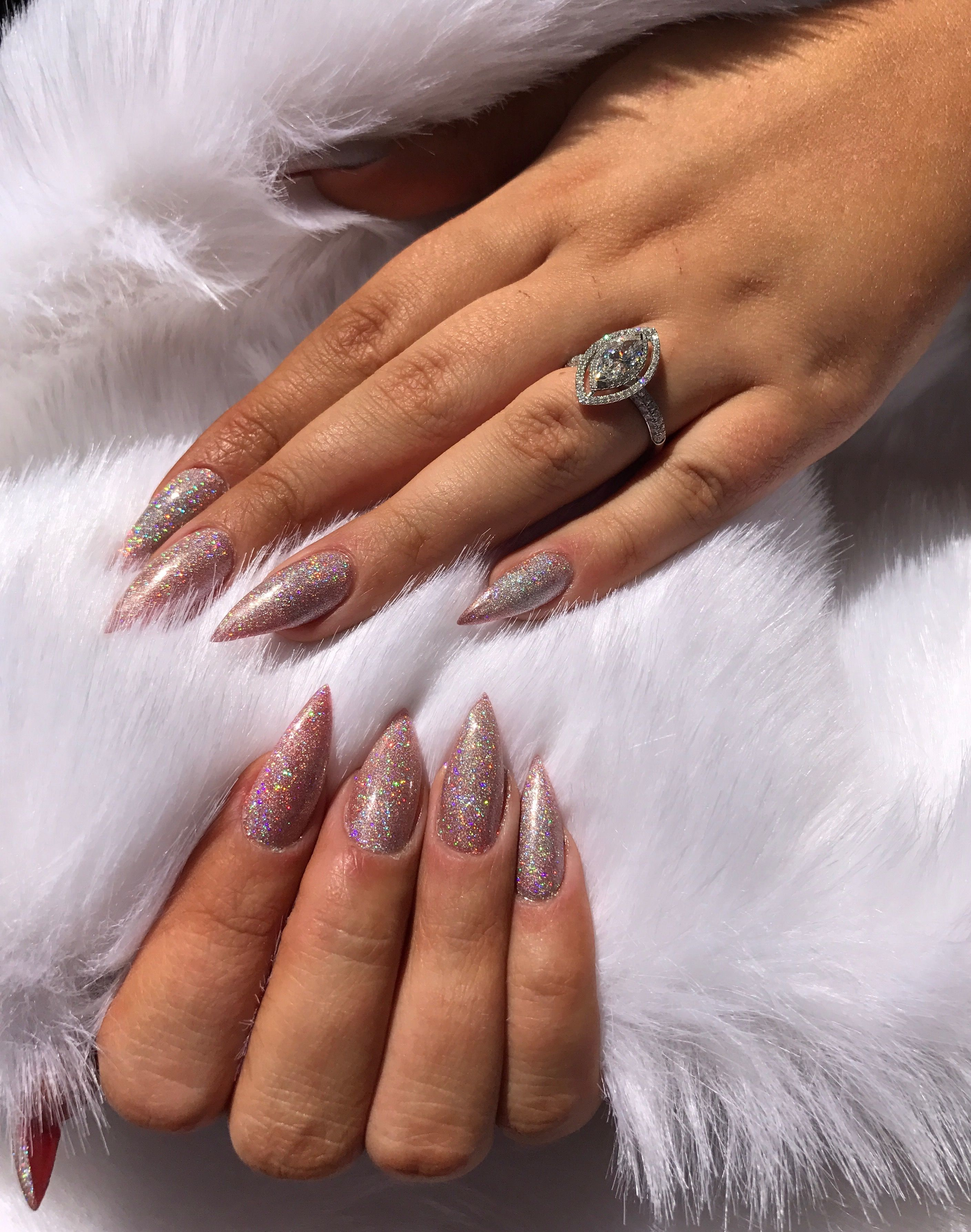 Holographic glitter stiletto acrylic nails. Marquise engagement ring ...