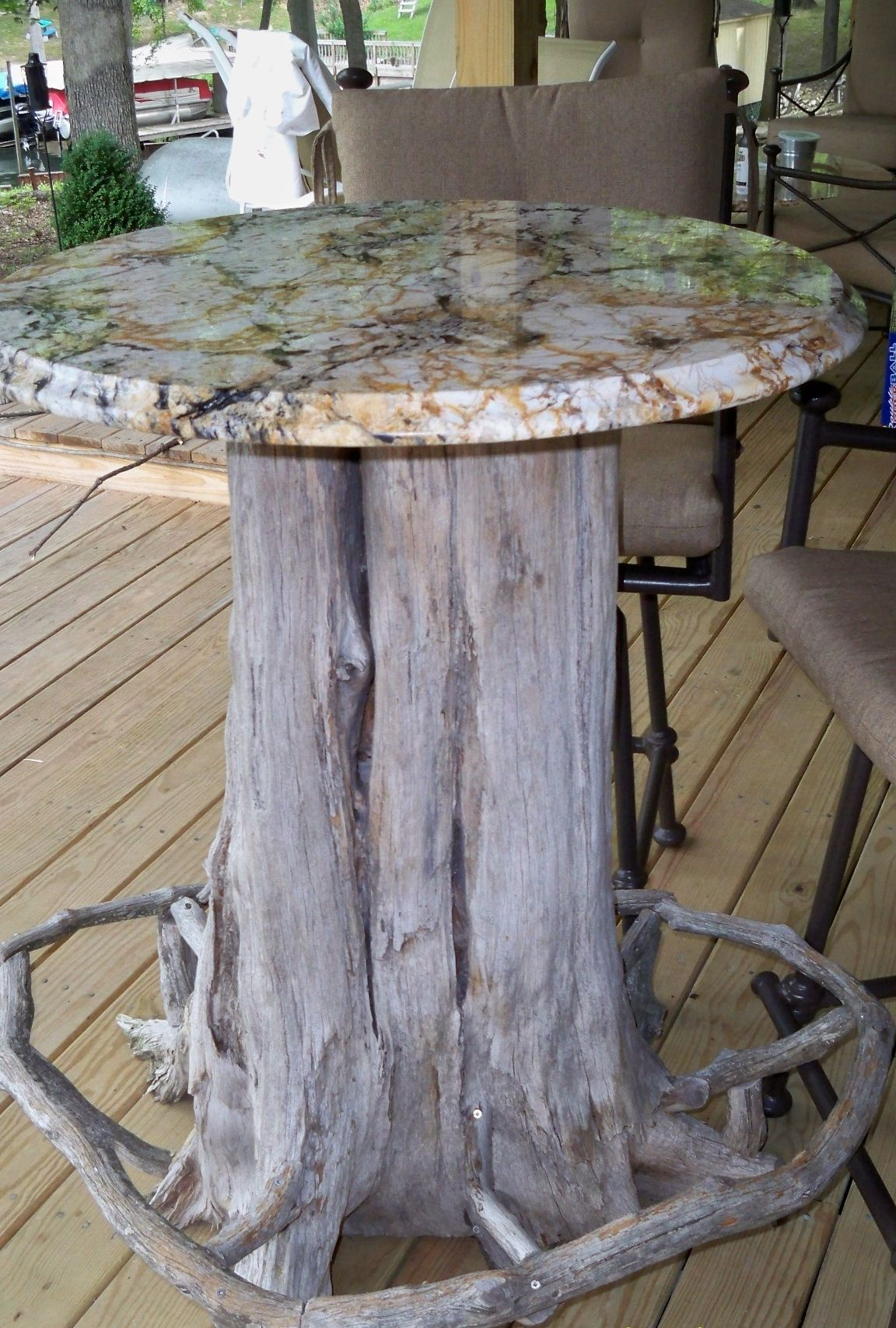 Tree trunk bar table with granite top  Notice the foot rest  My hubby made. Tree trunk bar table with granite top  Notice the foot rest  My