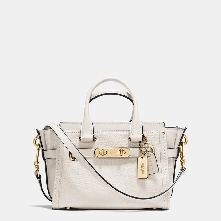 34a3e67eca53 Trending On ShopStyle - Coach Swagger 20 In Pebble Leather. Finished by  hand in refined