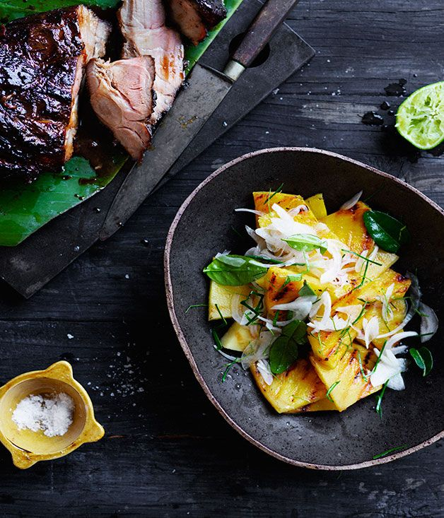 This soy pork salad is equally delicious with the pineapple simply chilled rather than  120 gm light palm sugar, grated or crushed 125 ml (½ cup) kecap manis 80 ml (⅓ cup) fish sauce 2 tsp finely grated ginger 1 star anise, crushed 1 boneless pork neck (1.3kg)   Pineapple salad 1 ripe pineapple, peeled, thinly sliced and cut into wedges ½ Spanish onion, thinly sliced 4 kaffir lime leaves, very thinly sliced, plus extra leaves to garnish Juice of 3 limes barbecued.