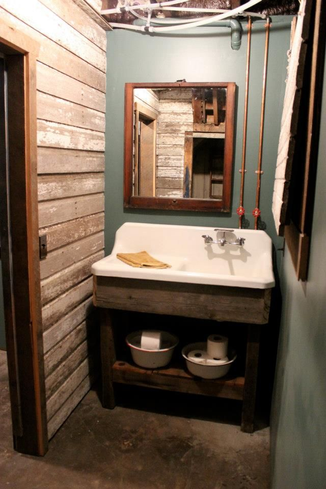 Historic remodel named Bea.  The original kitchen sink in the basement bath on a salvaged barn wood base.