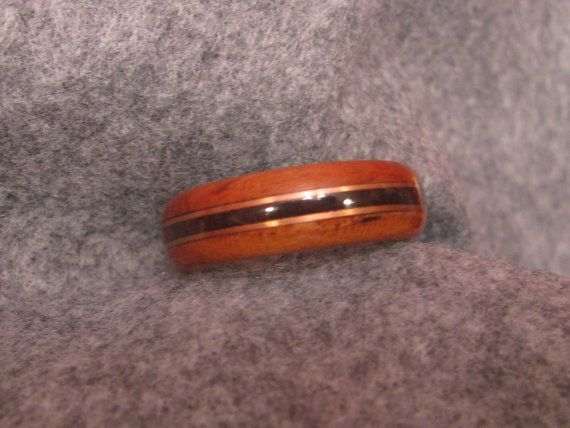 """3/8"""" wood band of walnut, copper, and cherry on Etsy, $100.00"""
