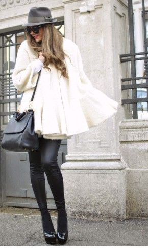 white cape + black LEATHER pants.  love the leather.