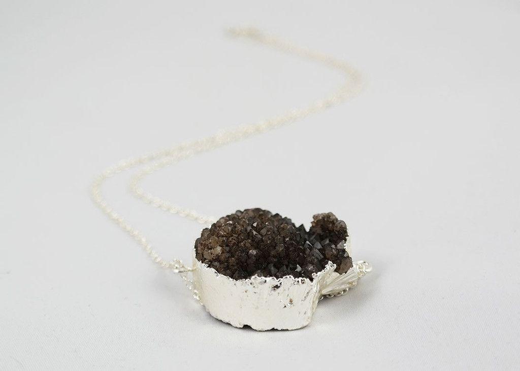 Black quartz cluster druzy pendant with silver detailing.