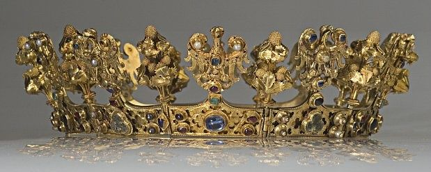 The Bohemian Crown of Queen Eliska. In 1303 she arrived in Prague and was crowned Czech and Polish queen. The crown is a unique piece of art, which has no parallels in the world. It is the only existing crown with eagles, which were an element of crown jewels after the 13th century, relating to the tradition of the empire.