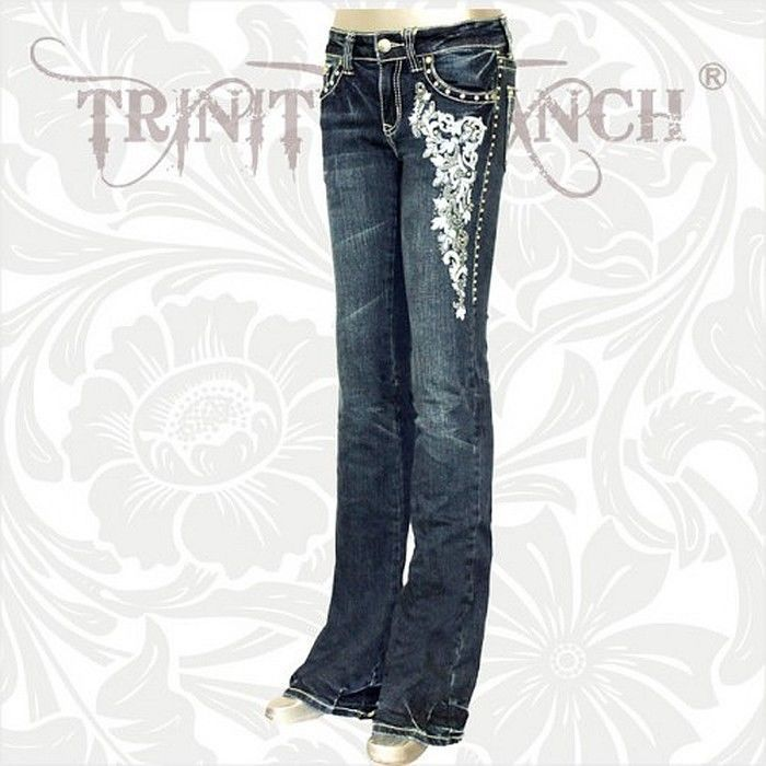 Embroidered design with grays and light blues on the front leg to just above the knee and on right back pocket. Description from theyeehawcowgirl.com. I searched for this on bing.com/images