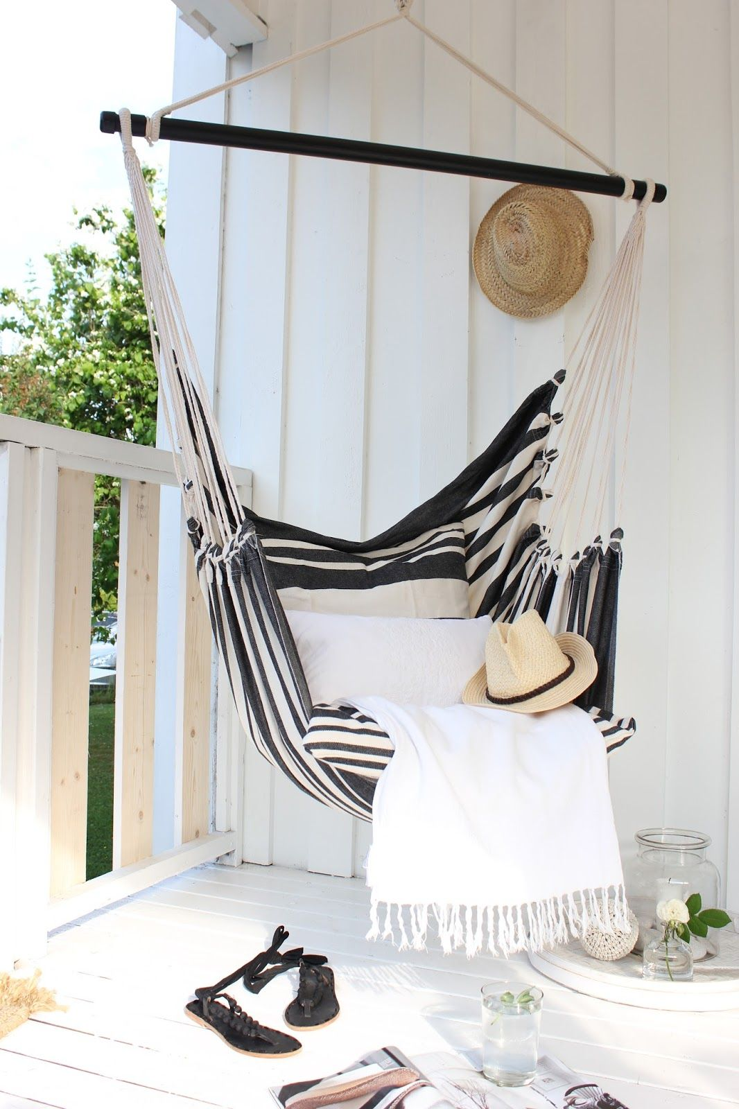 A mini hammock in black and white stripes is a sophisticated spin on the  relaxed design trend. - 10+ Pretty Little Porches & Patios Outdoor Space Porch, Patio